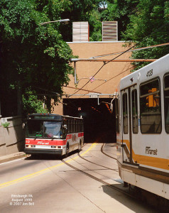 Present day bus and light rail vehicle on south side of transit tunnel.