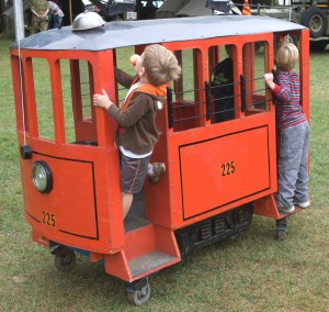 These boys seem to be checking why their miniature trolley isn't going anywhere.