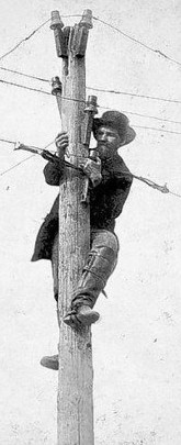 Lineman repairs telegraph wire about 1863. The glass insulators are still commonly sold at flea markets and antique shops for home decorating.
