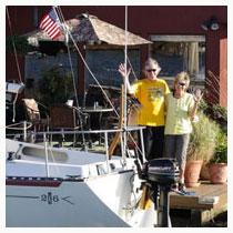 Bridgetown Neighborhood with couple on houseboat