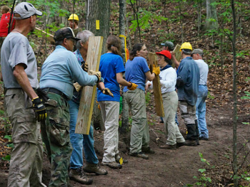 Group of volunteers building a trail
