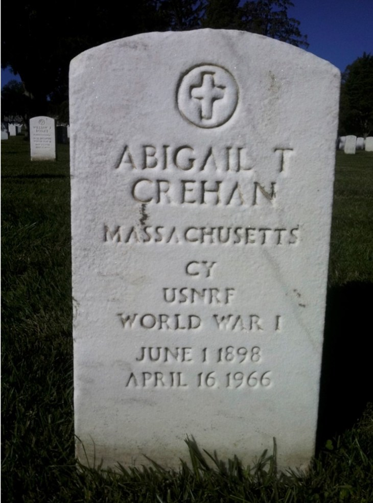 Color photograph of marble headstone with cross and name Abigail T Crehan