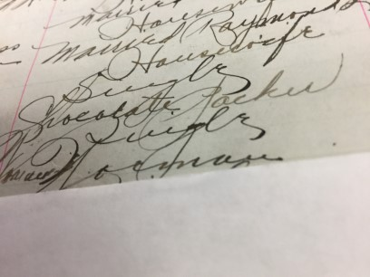 Yellowed paper of a register with signatures