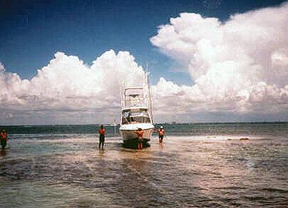 Powerboat hard aground