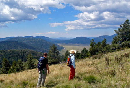 Photo of hikers on the Cerro Grande Trail at Bandelier National Monument