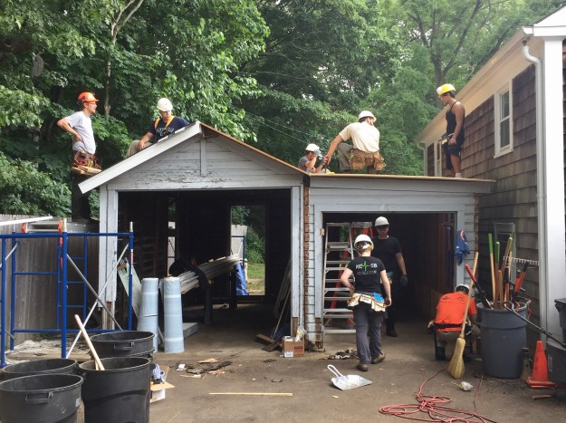 Students working on historic shed.