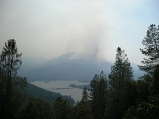 Smoke billowing from fires burning on Shasta Bally in Whiskeytown National Recreation Area