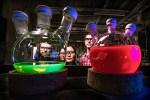 Photo shows solutions of all-inorganic perovskite quantum dots illuminated with UV light.