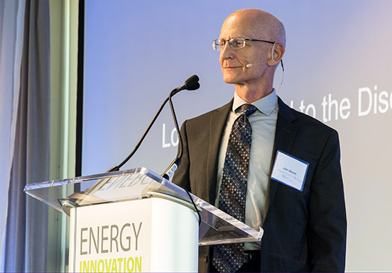 NREL Energy Security and Resilience Center Director John Barnett stands at podium during 2019 Partner Forum at NREL.
