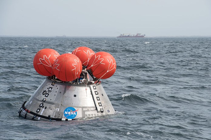 A space crew module floating in the ocean