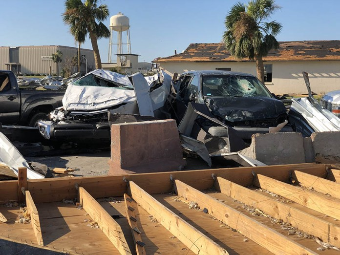 Parked vehicles damaged after a hurricane strike