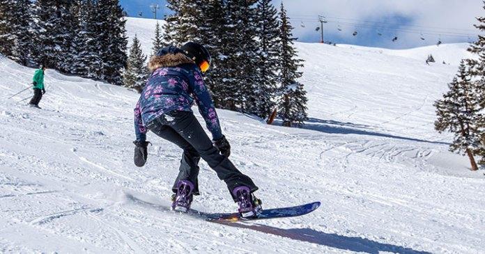 Charisa Powell in full snow gear snowboarding