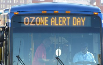 bus with text ozone alert day on display
