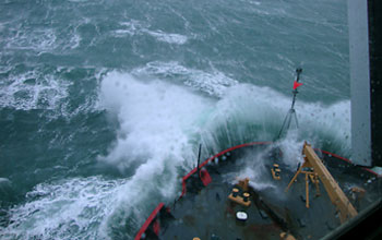 Photo of the USCGC Healy breaking through the Bering Sea waves.