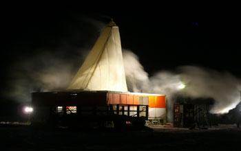 drilling rig at night