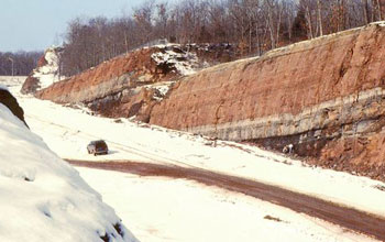 Road passing through snow covered ancient rocks in Hartford Basin, Conn.