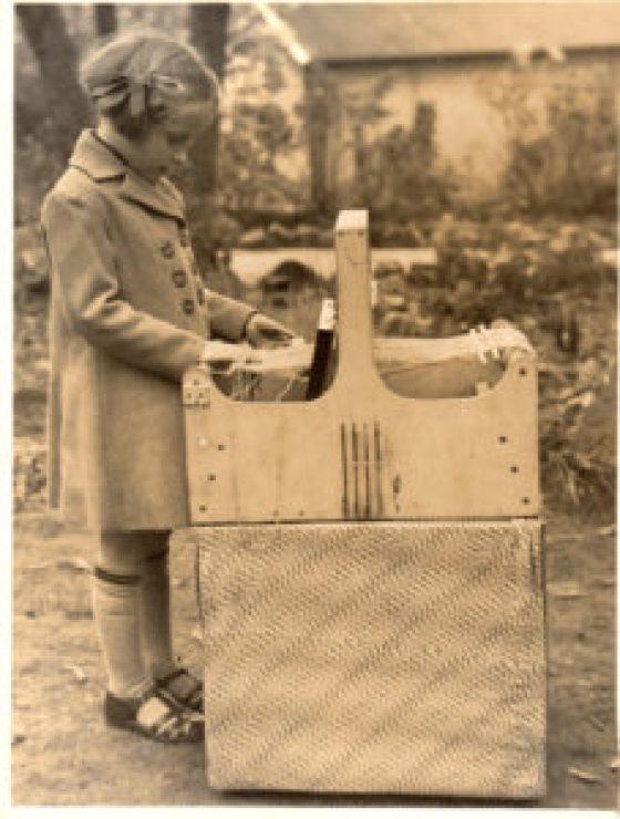 H E Clark's daughter weaving.