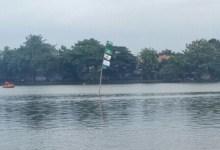 Photo of Semarakan Harlah NU ke 95, Bendera NU Berkibar di Tengah Setu Cilodong Depok