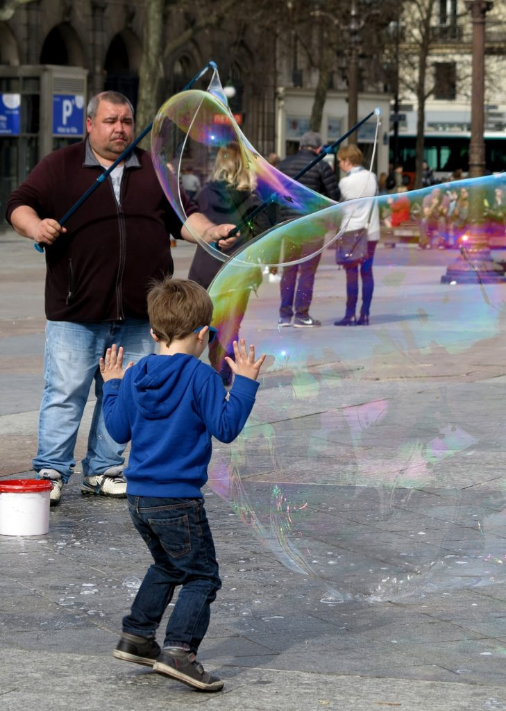 Paris Street Performer making Bubbles with Little Boy