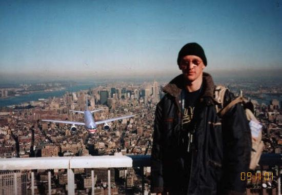 A photo of a plane approaching from behind a man allegedly standing on top of one of the World Trade Center towers