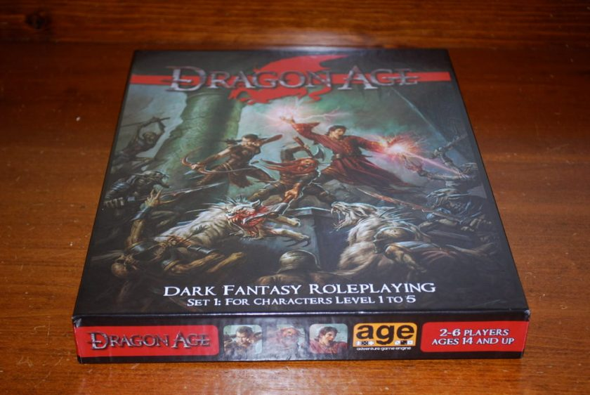 The box for Dragon Age, Set 1 features several heroes fighting dark spawn monsters.