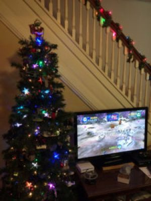 The geek Christmas tree next to a television displaying the LEGO Clone Wars video game.