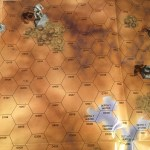 An aerial view of the combat shows four mechs battling.