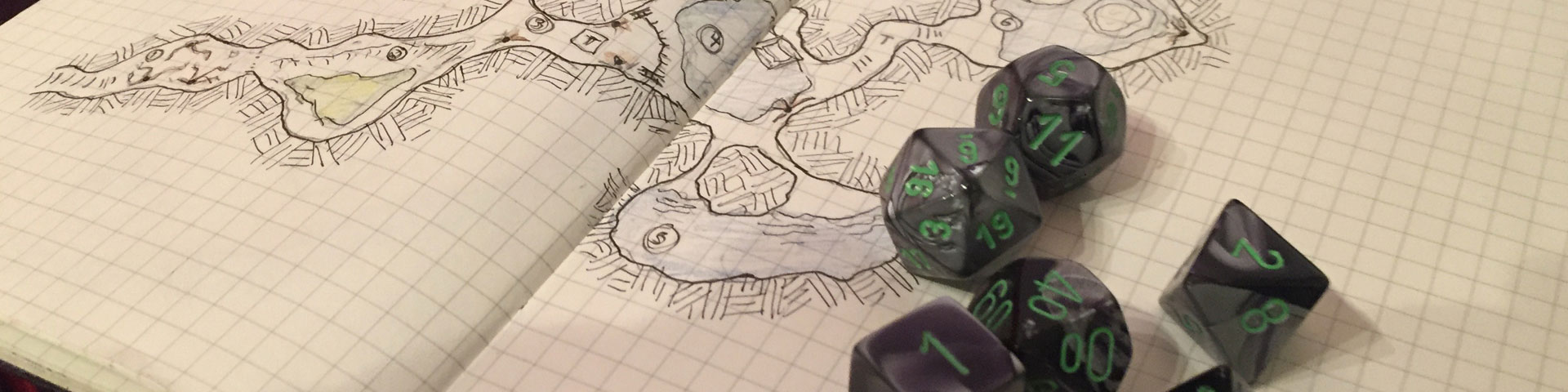 Green and grey dice sit atop a hand-drawn dungeon map.