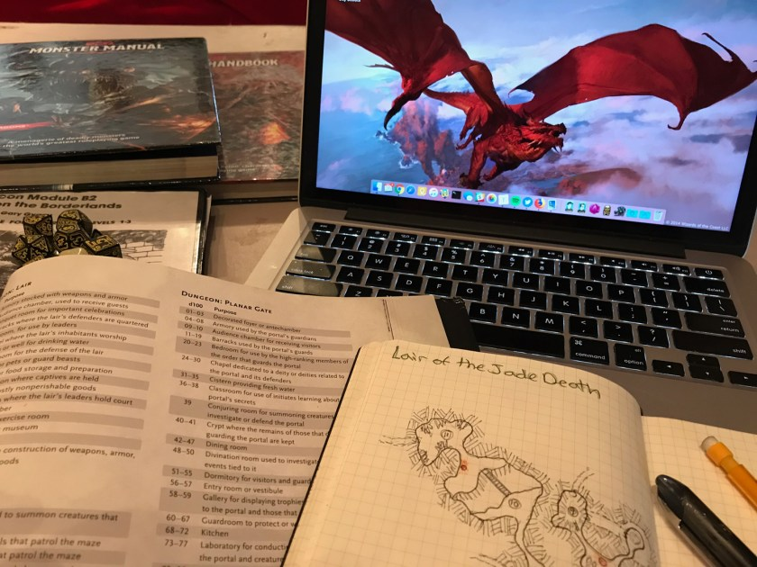 A laptop computer surrounded by role-playing game source books.