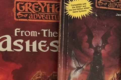 Two RPG boxed sets and two RPG books, all connected to the World of Greyhak campaign setting.