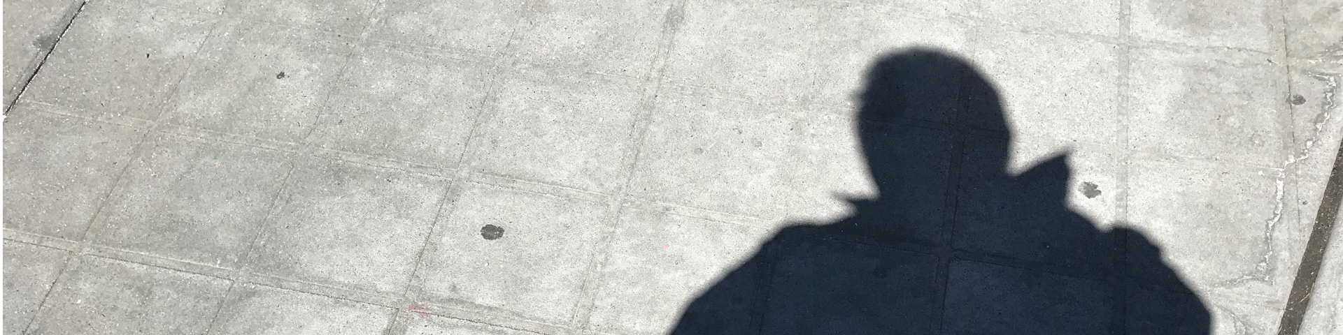 A man's shadow on a sidewalk