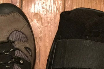 A picture of my left foot (wearing a hiking boot) and my right (wearing a structural boot)