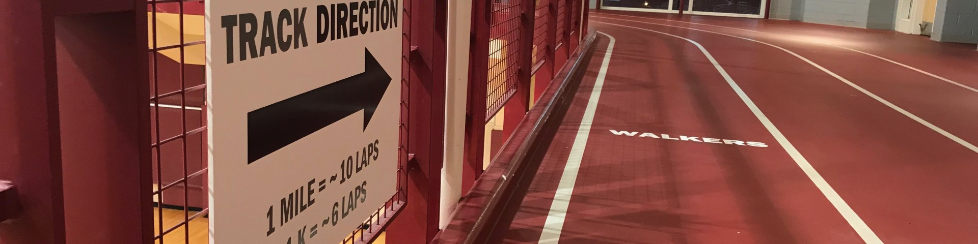 """An indoor track with the """"today's direction"""" sign."""
