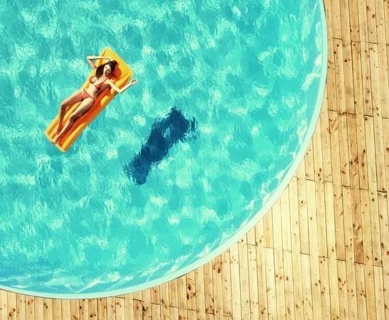 Number 4 Hair Care Woman Floating in Pool Shark Awareness Week