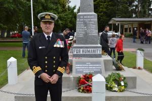 Commander Fotheringham beside the cenotaph.