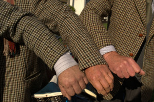 The gentlemen comparing their tweed. Attire was taken very seriously indeed.