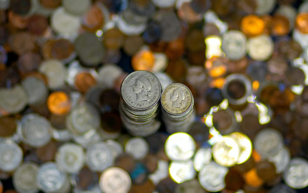 Piles of coins; Numberslides helps you manage your cash flow