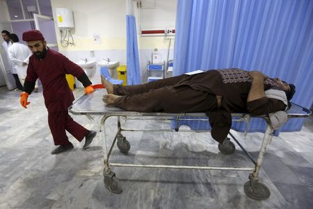 An Afghan man arrives for treatment at a hospital after a suicide car bomb attack in Kabul, Afghanistan April 19, 2016. REUTERS/Omar Sobhani