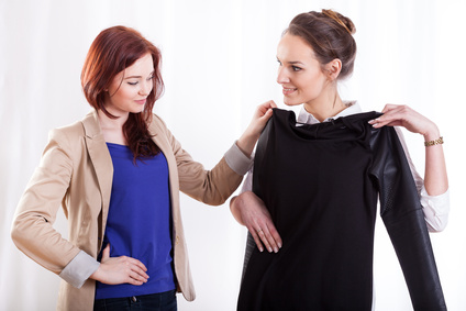Women choosing clothes together on isolated white background