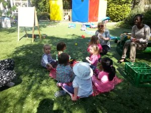 Nursery Children enjoy picnic