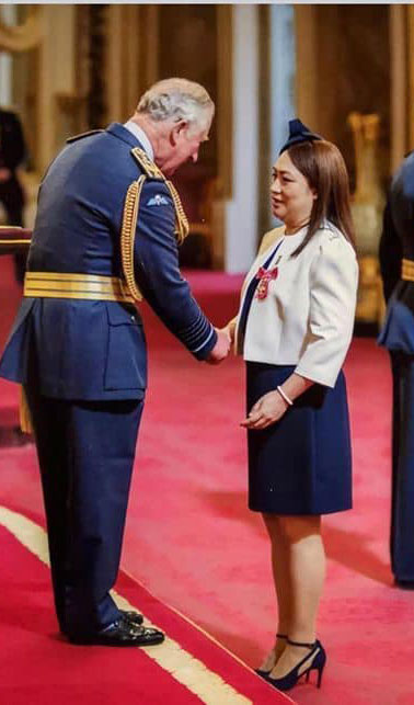 Prince Charles shakes hand of nurse Joy Ongchauco.