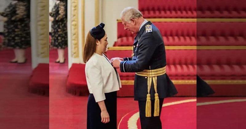 LOOK: Prince Charles pins Order of British Empire Award to Filipino nurse