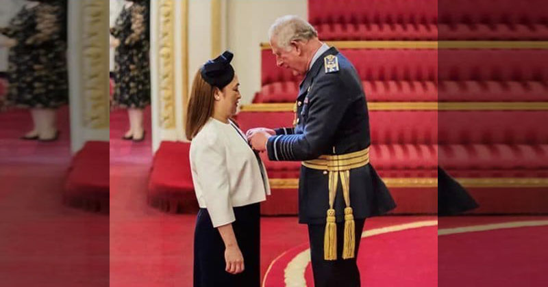 LOOK: Prince Charles pins Order of British Empire Award to Filipino nurse
