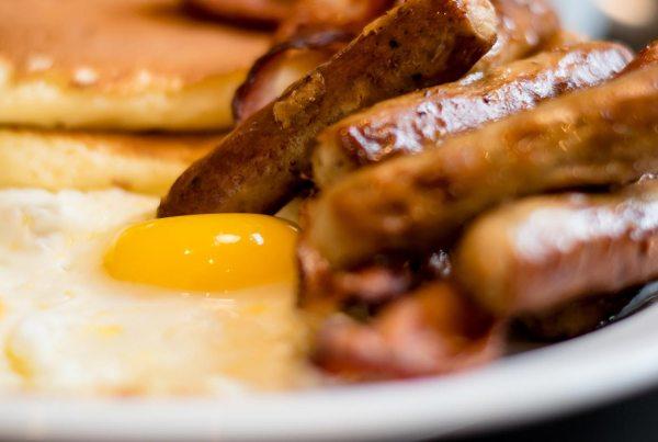 Eggs, Sausage, OJ, & Pancakes