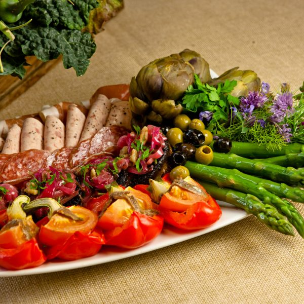 Sharing Antipasti Platters of Cured Meats, Salami, Chargrilled Asparagus...
