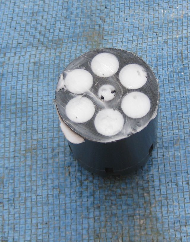 cylinder with each of the 6 chambers covered with Crisco