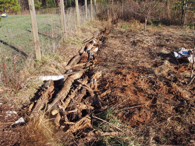 various logs stacked in the rainwater ditch