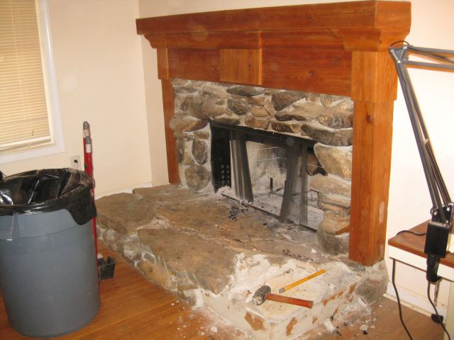 the fireplace has/had a nice stone surround and attractive mantle - demolition has commenced