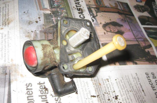 the red button is the primer button which you press a few times to fill the carburetor with gas.