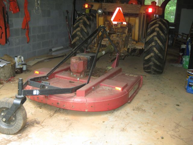 Bush Hog attached to Case tractor